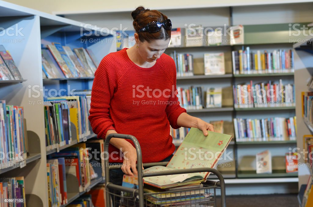 Woman in Library stock photo