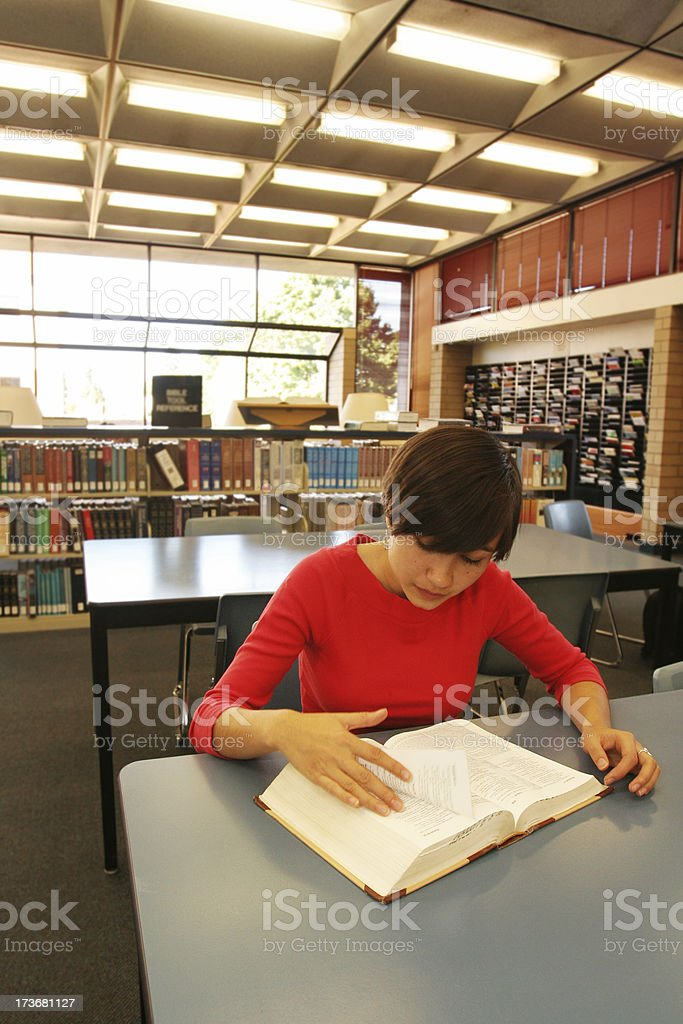 Woman in Library Reading royalty-free stock photo