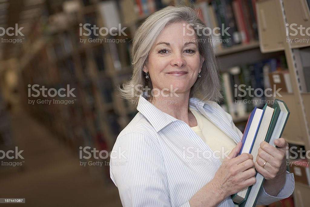 Woman in Library Series (XXL) stock photo