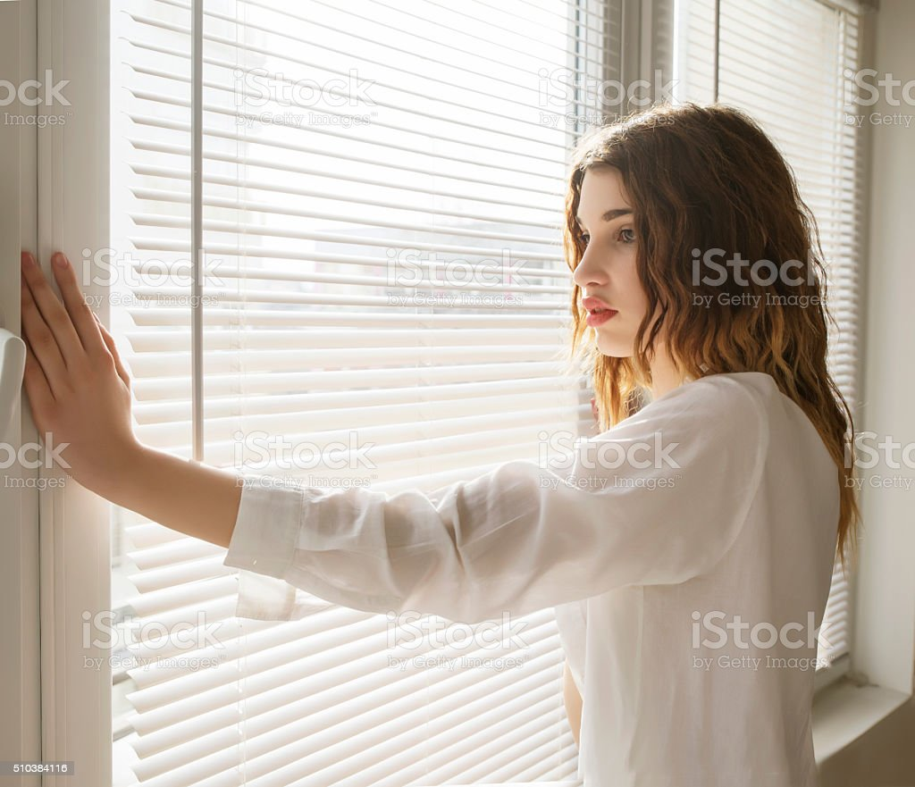 Woman in lingerie and t-shirt stock photo