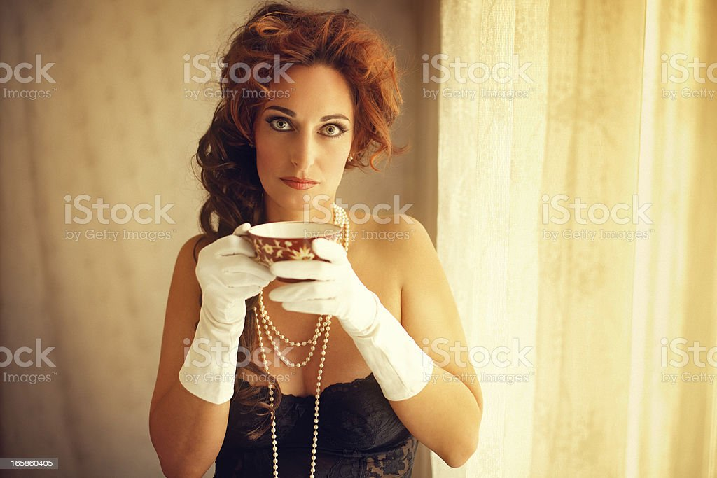 woman in lingerie drinking tea by the window royalty-free stock photo