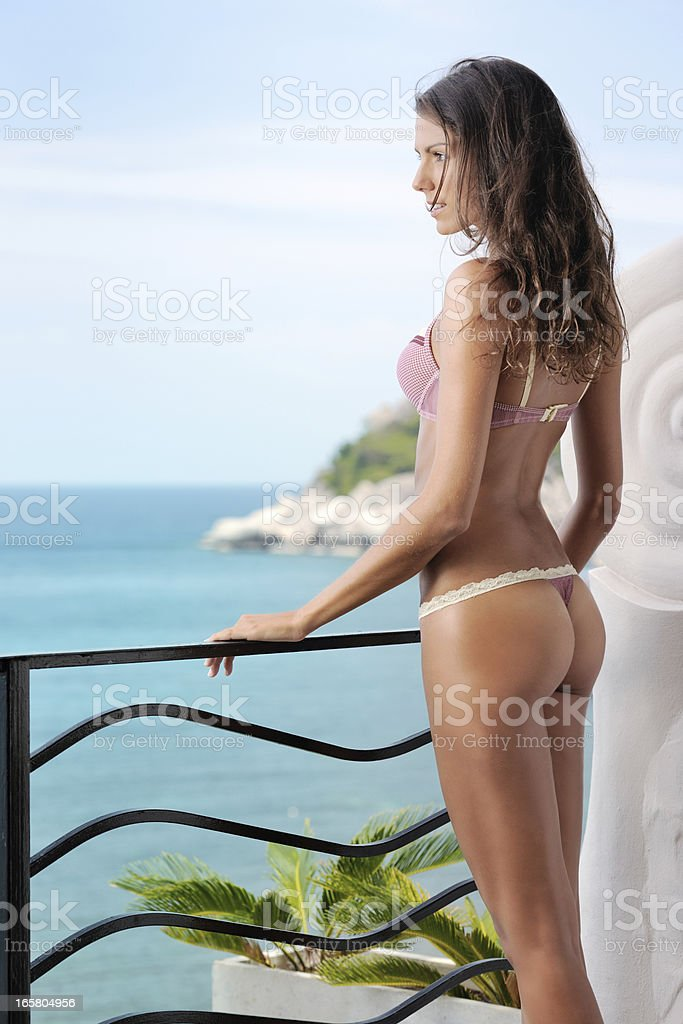 Woman in Lingerie enjoying the Ocean View royalty-free stock photo