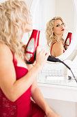 Woman in lingerie holding hair dryer