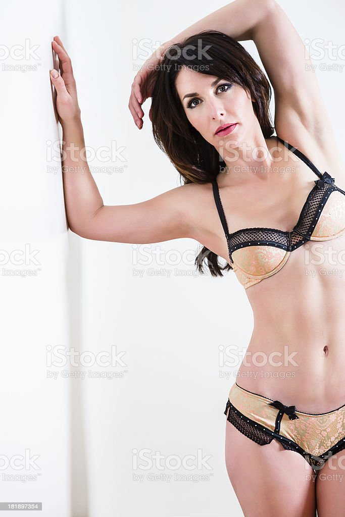 Woman in lingerie leaning on wall royalty-free stock photo