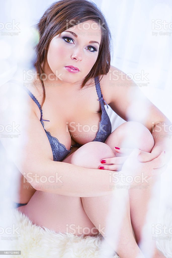 Woman in lingerie sitting on couch royalty-free stock photo