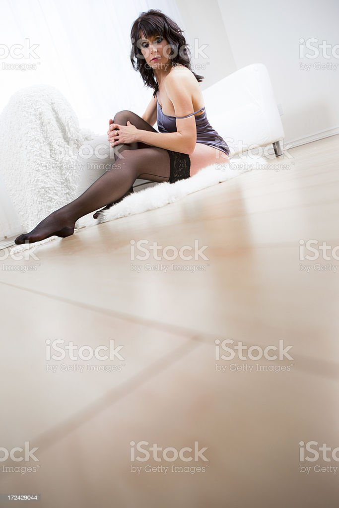 Woman in lingerie sitting on floor royalty-free stock photo