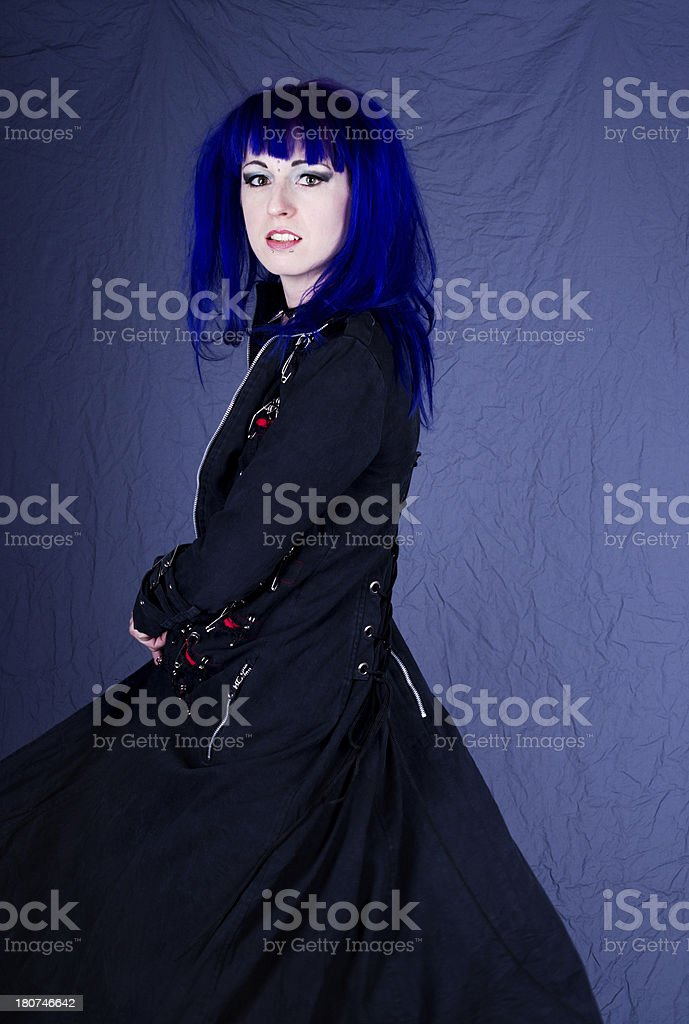 Woman in long black coat turning. royalty-free stock photo