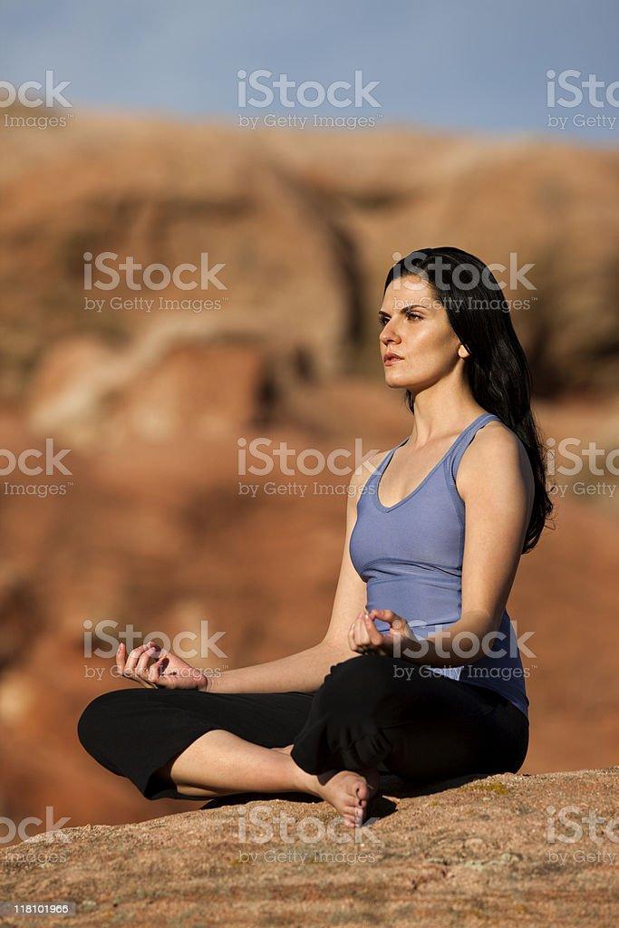 Woman In Lotus Pose (Padmasana) royalty-free stock photo