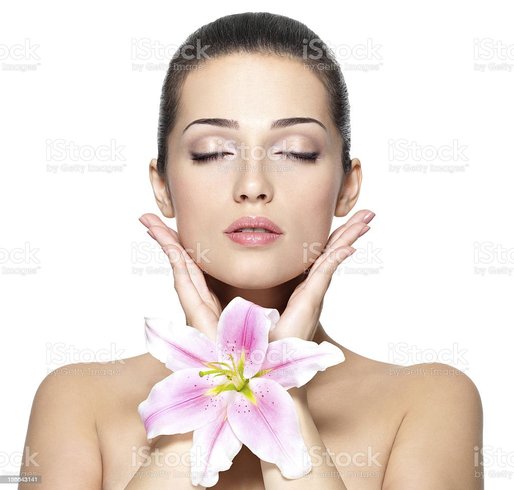 Woman in makeup with closed eyes and a large lily royalty-free stock photo