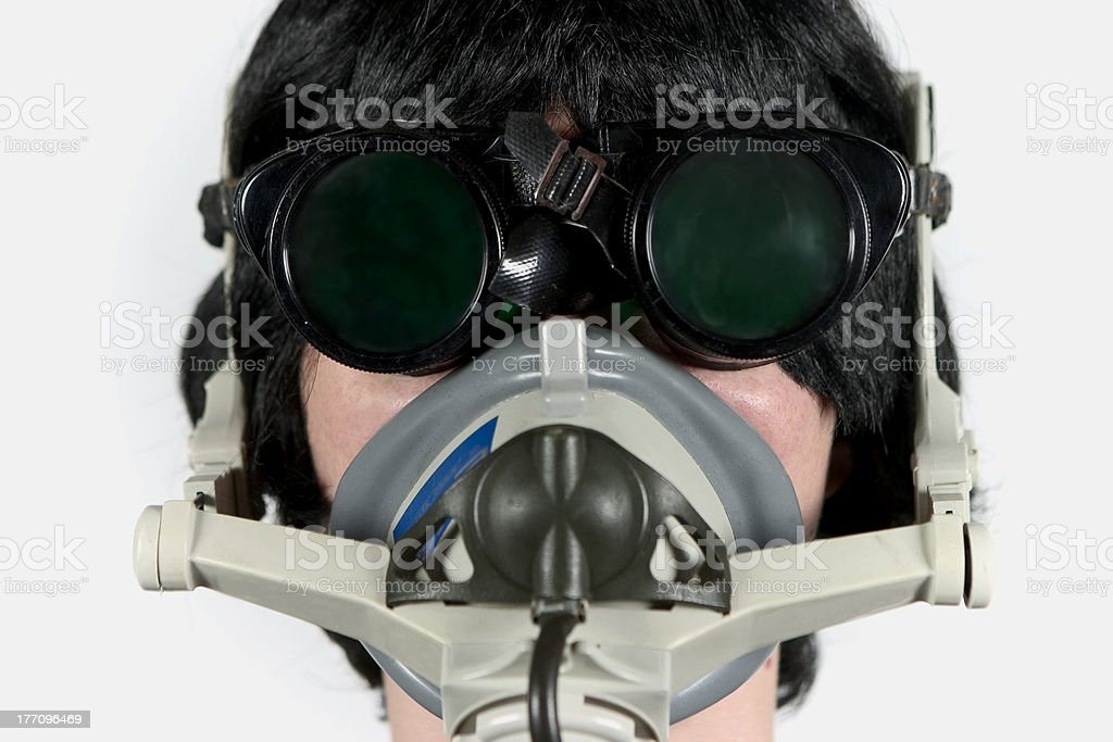 woman in mask and goggles stock photo
