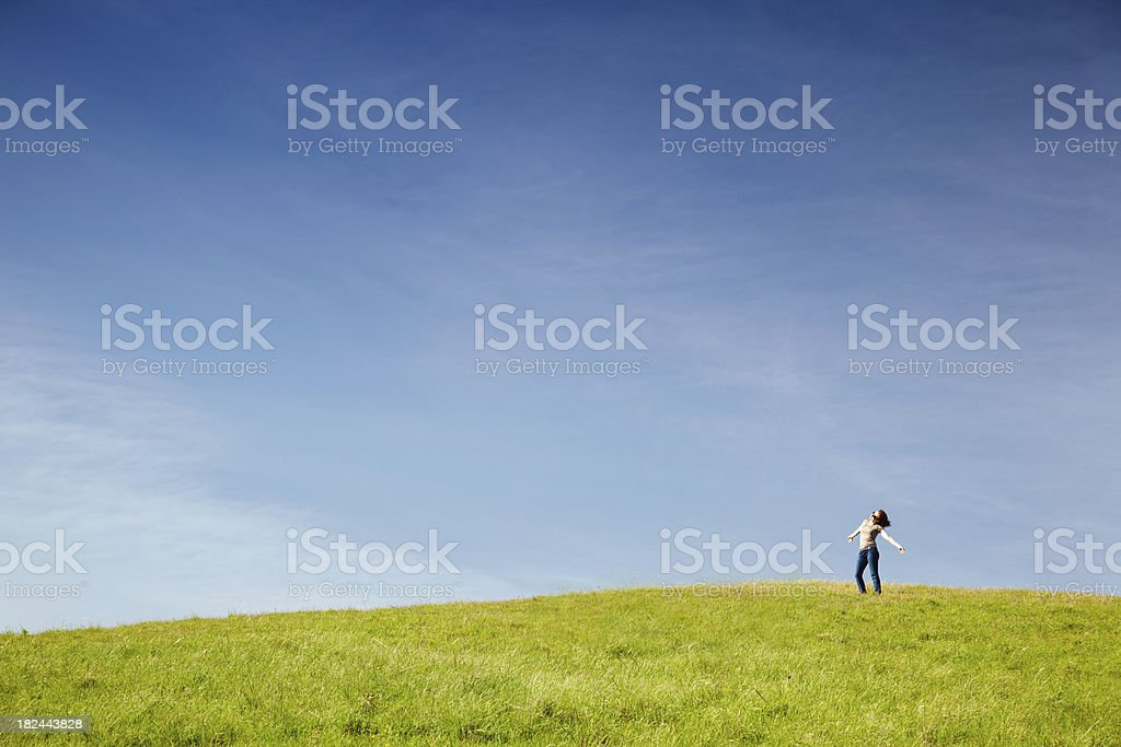 Woman in Meadow With Arms Outstretched royalty-free stock photo