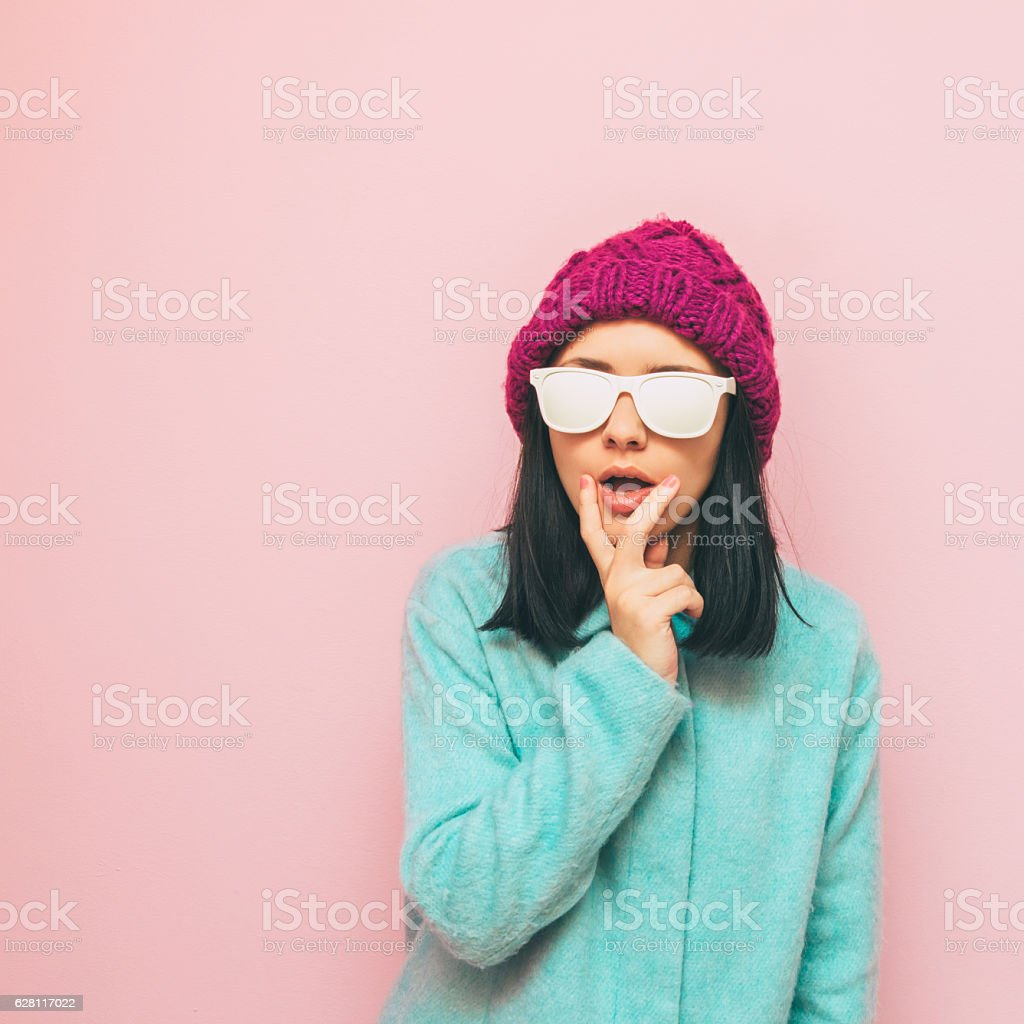 woman in mint coat stock photo