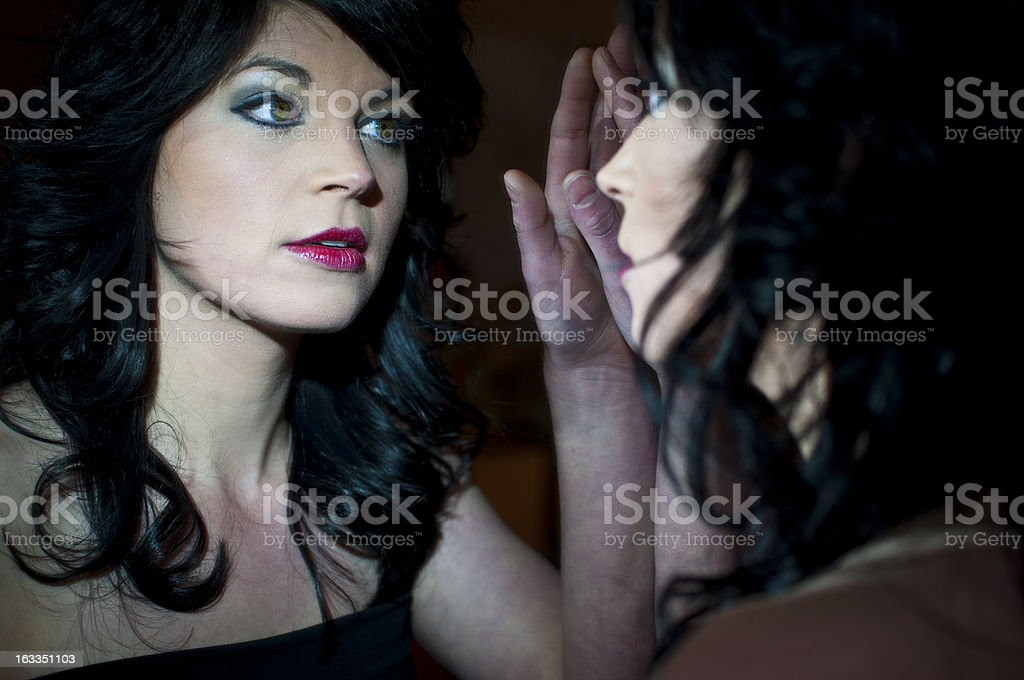 Woman in mirror royalty-free stock photo