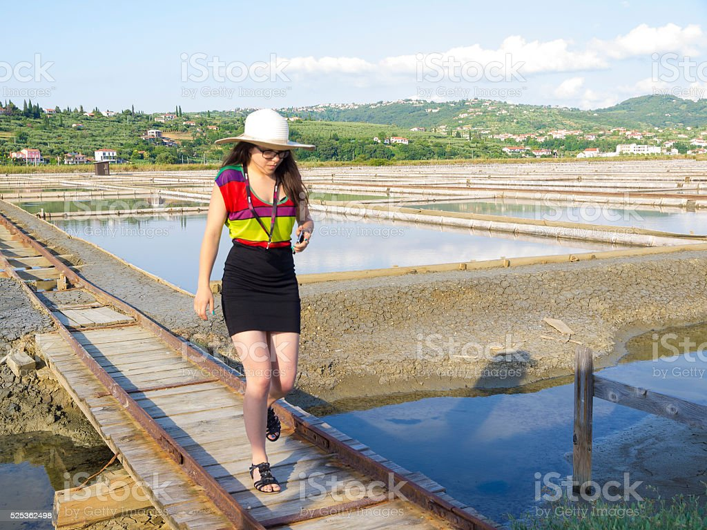 Woman in modern clothes walking at Soline in Slovenia stock photo