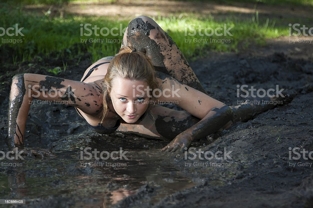 Woman in mud royalty-free stock photo