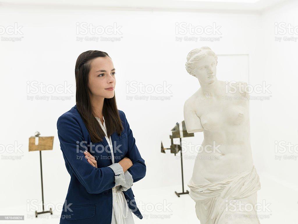 woman in museum looking at Venus de Milo statue royalty-free stock photo