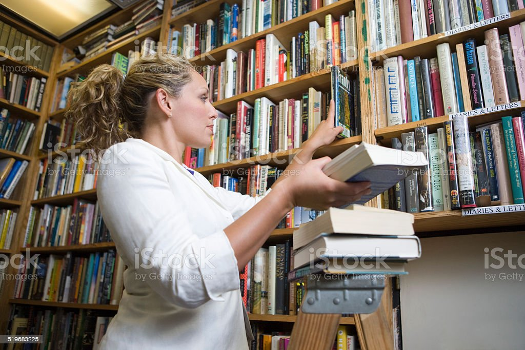 Woman in music shop stock photo