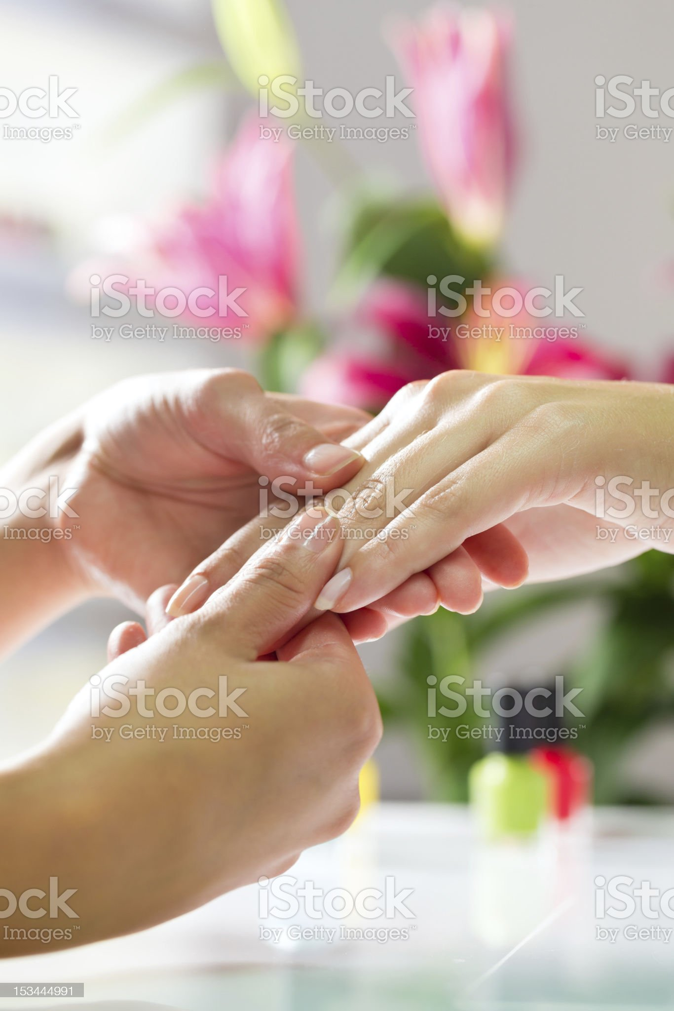 Woman in nail salon receiving manicure royalty-free stock photo
