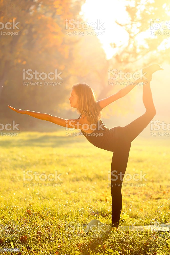 Woman in Natarajasana position stock photo