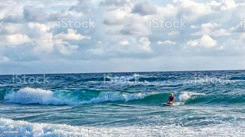 Woman In Ocean on Surfboard stock photo
