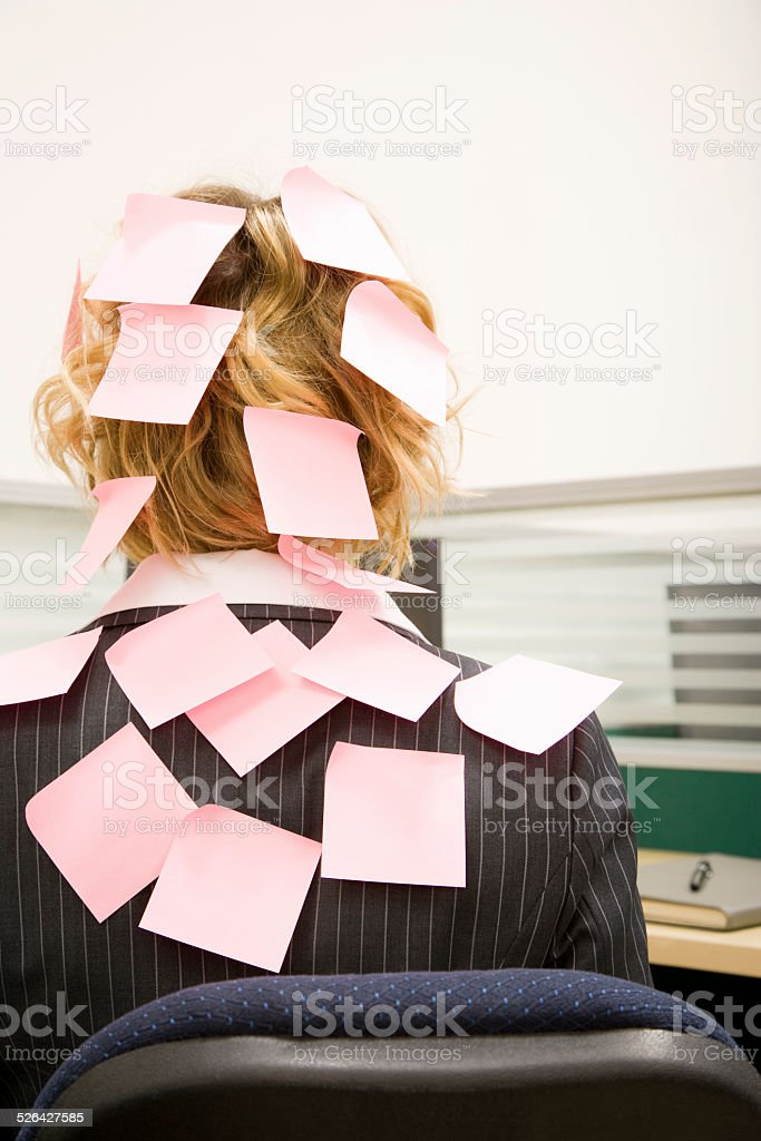 Woman in Office Covered With Pink Sticky Notes stock photo