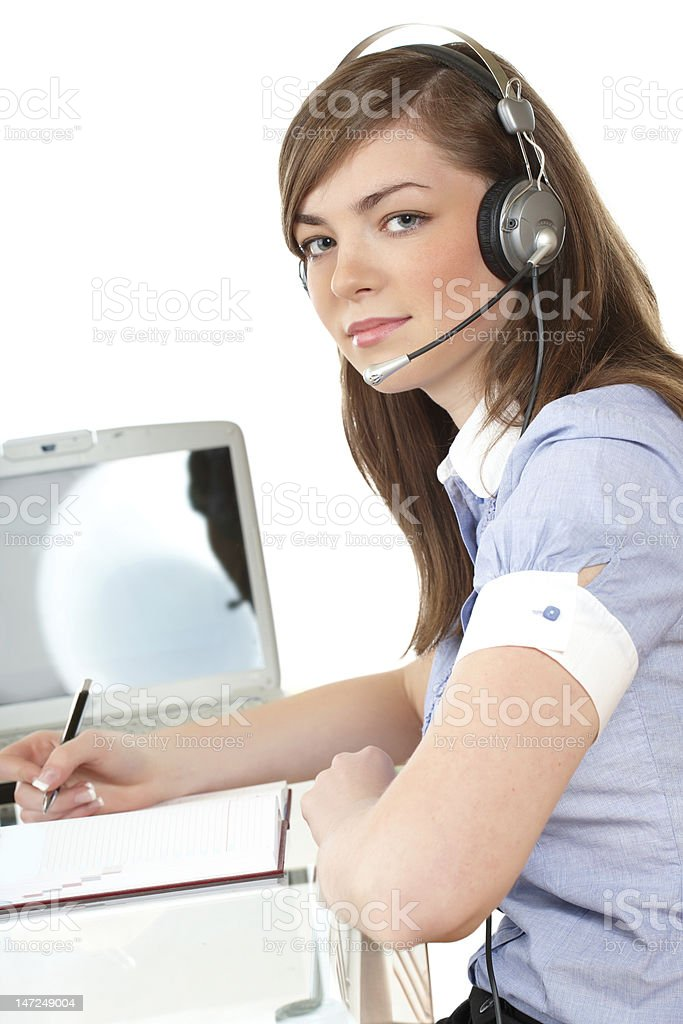 Woman in office with headset royalty-free stock photo