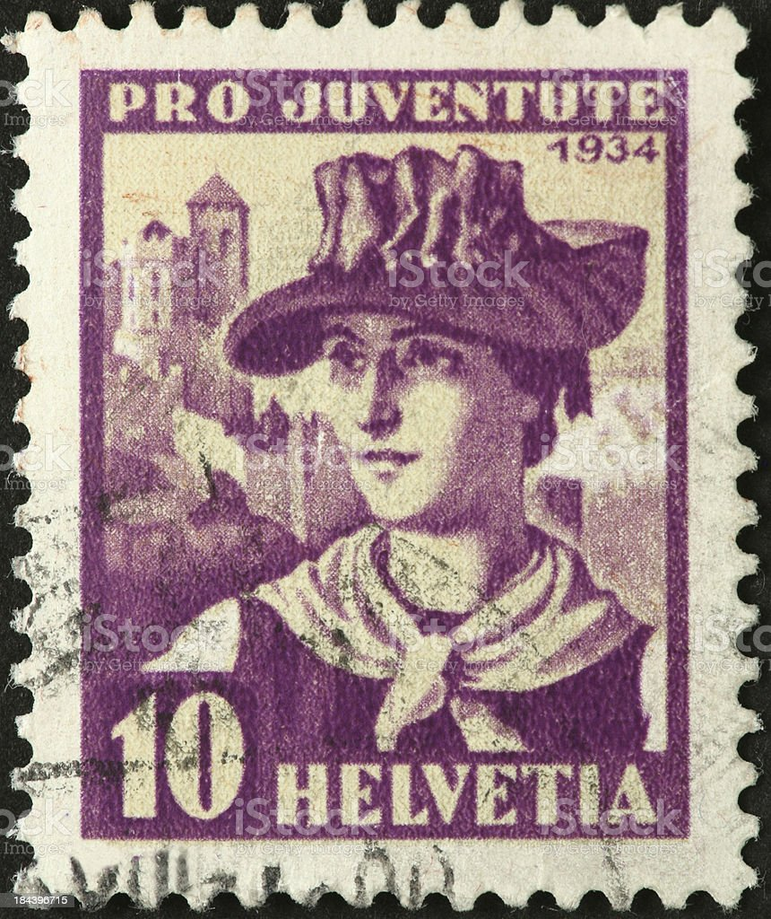 woman in old fashioned walking attire on Swiss stamp royalty-free stock photo