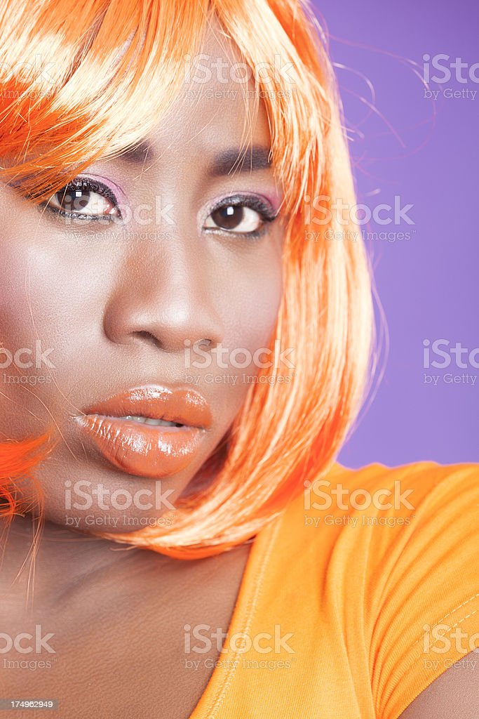 Woman in orange with wig royalty-free stock photo