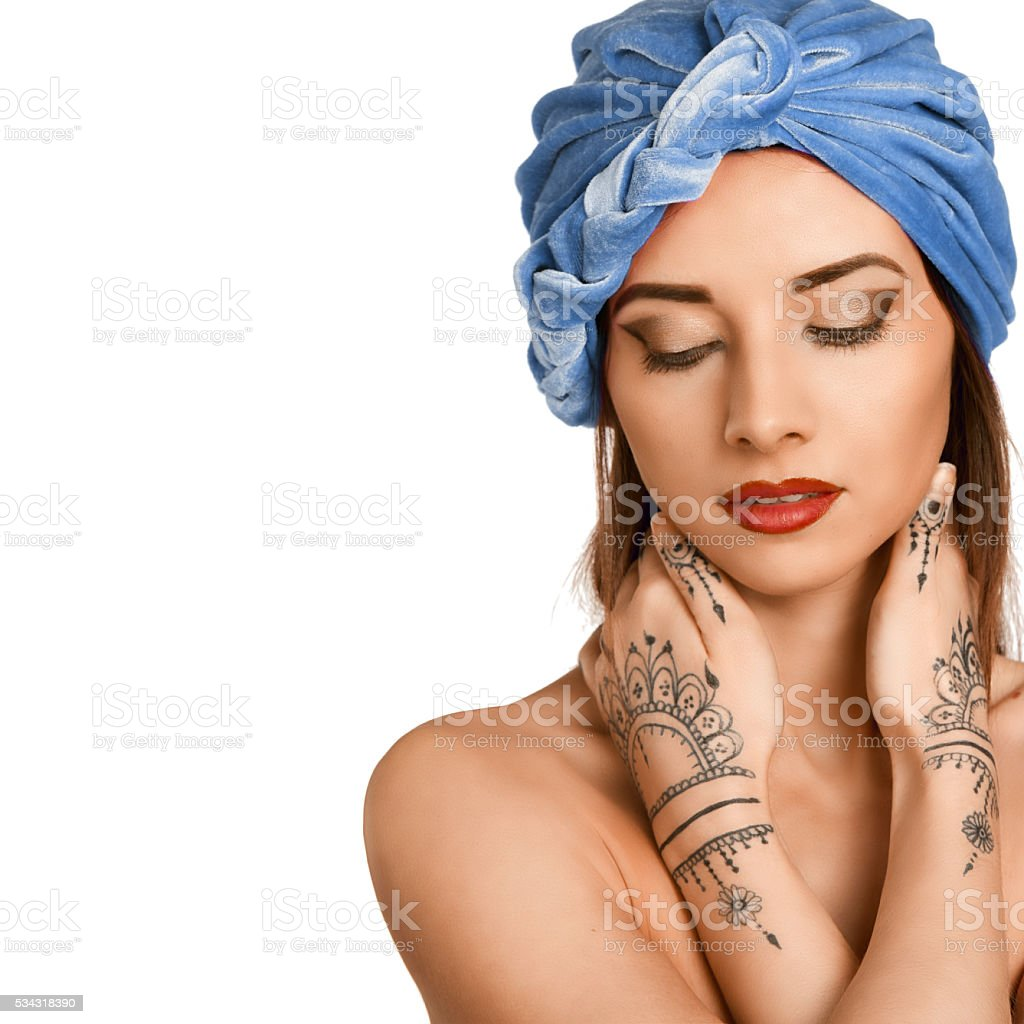 woman in oriental style with mehendy stock photo