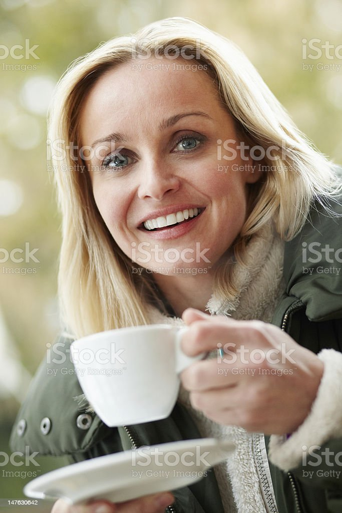 Woman In Outdoor Caf stock photo