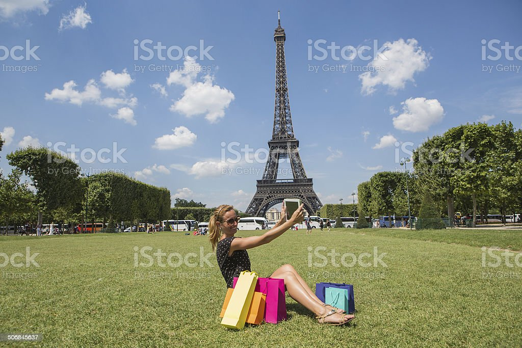 Woman in Paris taking picture with digital tablet royalty-free stock photo