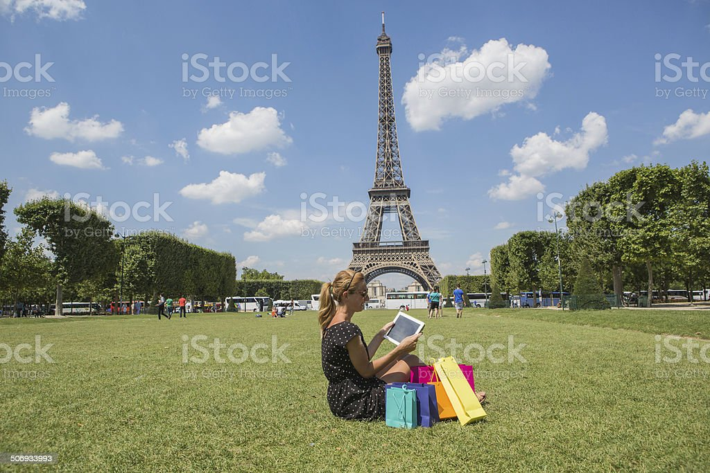 Woman in Paris using digital tablet royalty-free stock photo