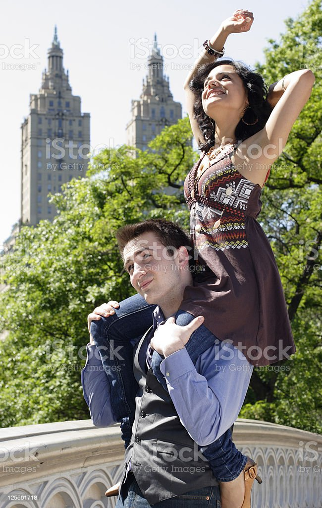 Woman in Park on a Man's Shoulders royalty-free stock photo