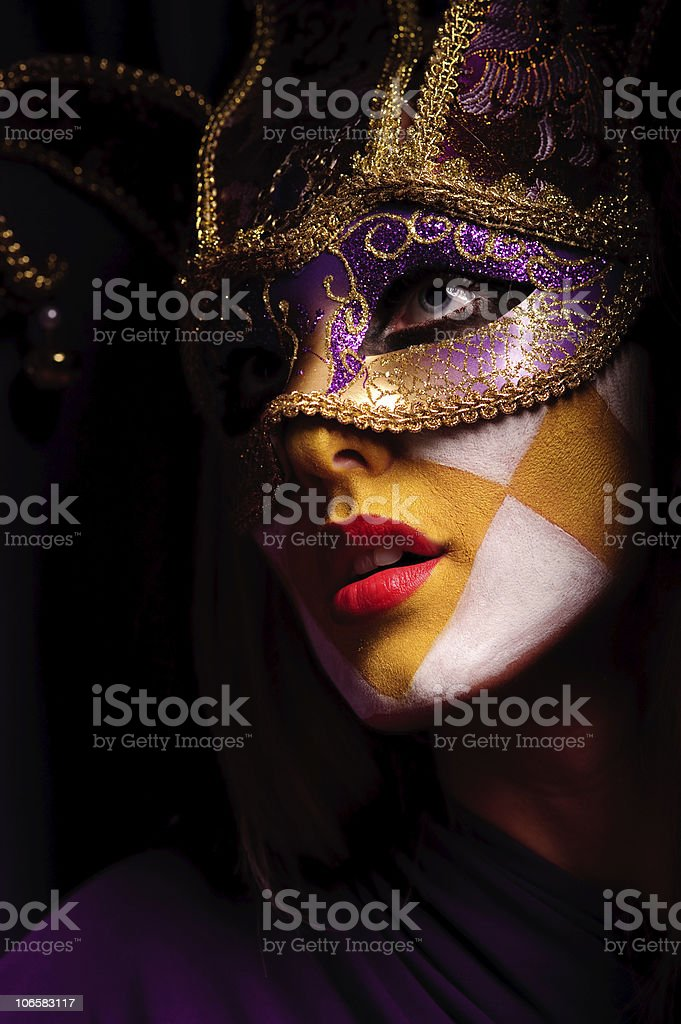 woman in party mask stock photo