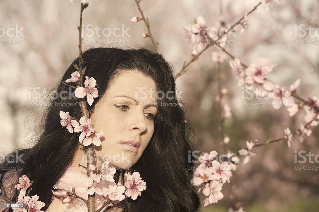 Woman in Peach Garden royalty-free stock photo