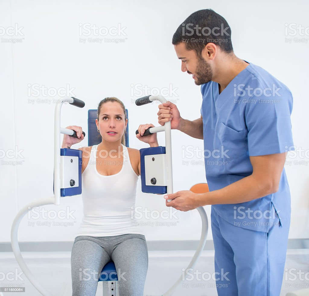 Woman in physiotherapy at the hospital stock photo
