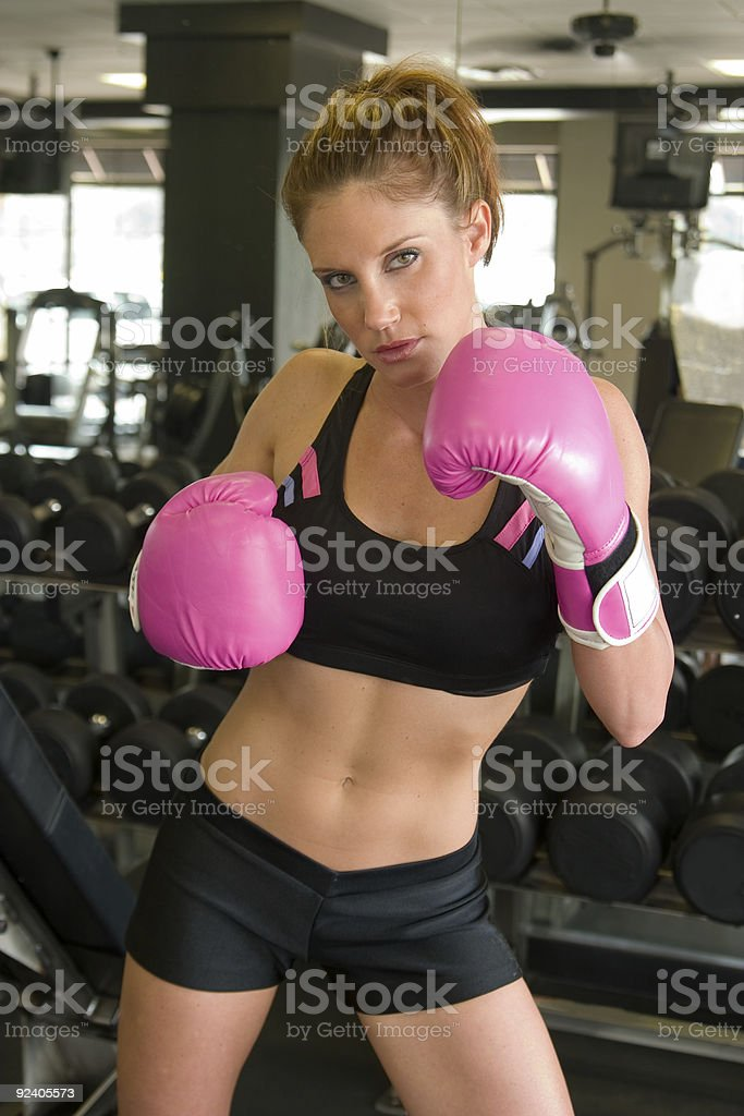 Woman In Pink Boxing Gloves royalty-free stock photo