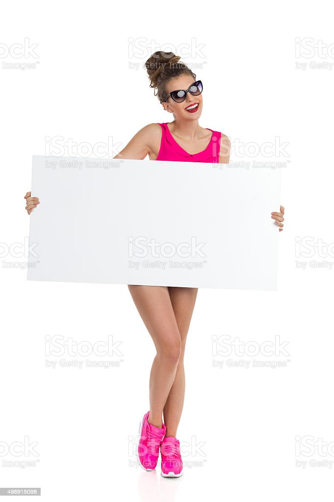 Woman In Pink Holding Banner stock photo