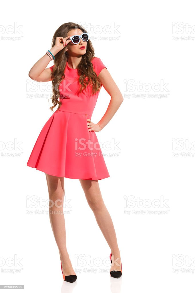woman In Pink Mini Dress And Blue Sunglasses stock photo