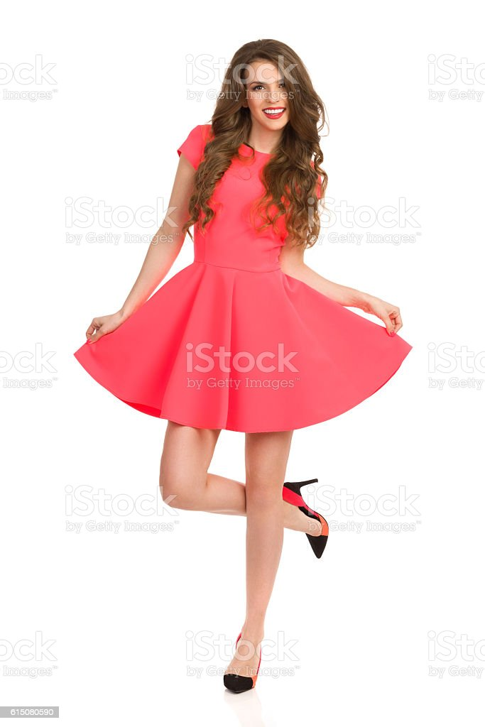 Woman In Pink Mini Dress Posing On One Leg stock photo