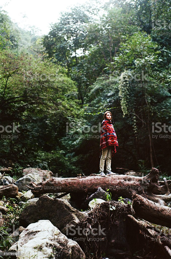 Woman in plaid in jungles stock photo