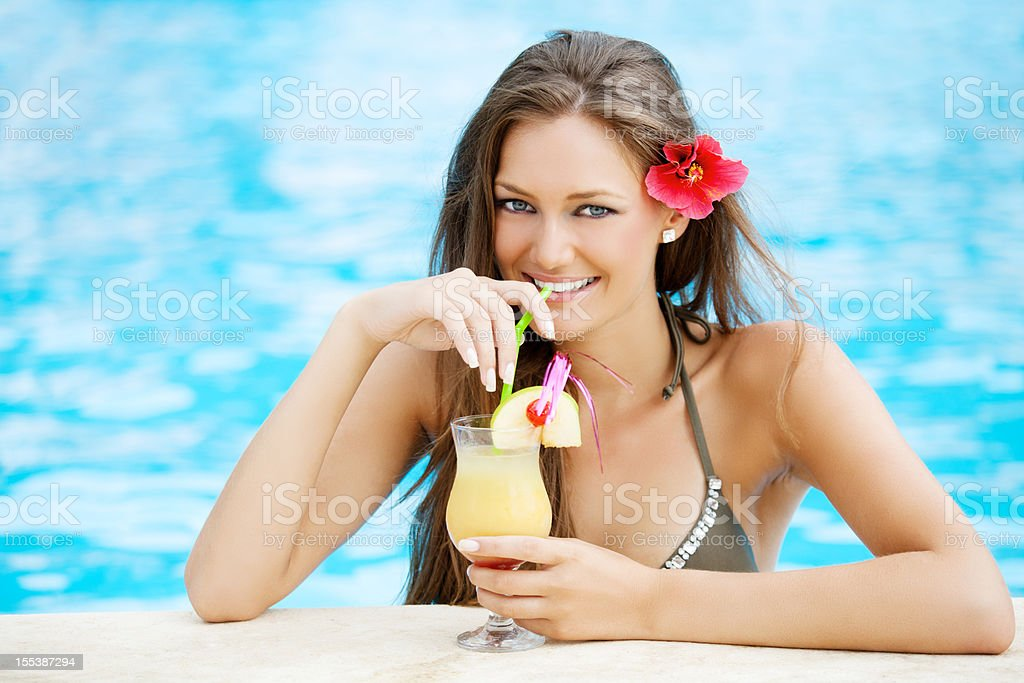 Woman in pool drinking alcohol royalty-free stock photo