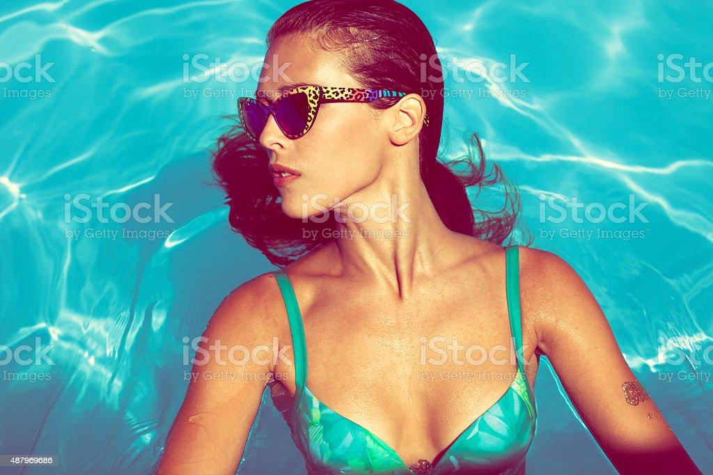 woman in pool stock photo