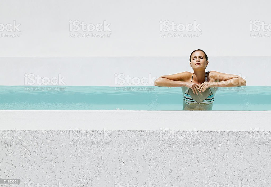 Woman in pool royalty-free stock photo
