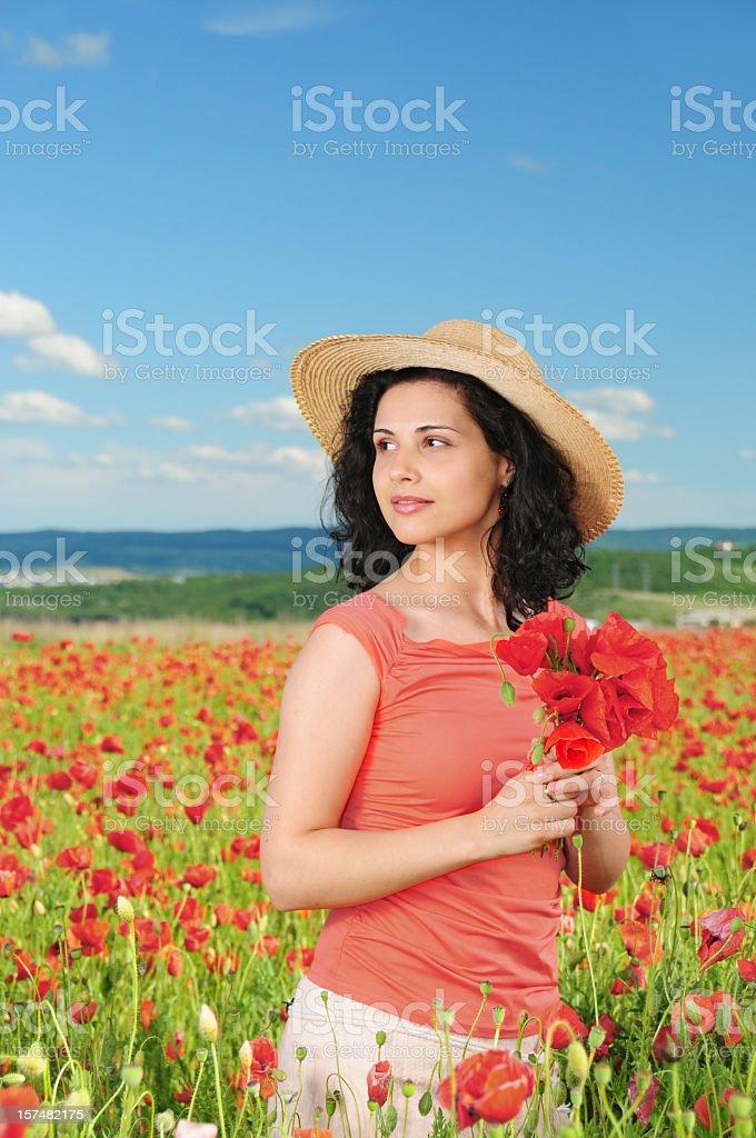 Woman in poppy field royalty-free stock photo