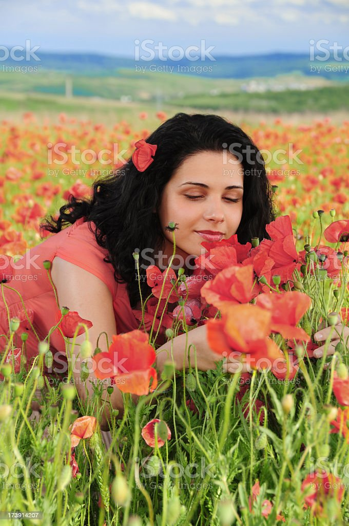 Woman in poppy field royalty-free stock photo