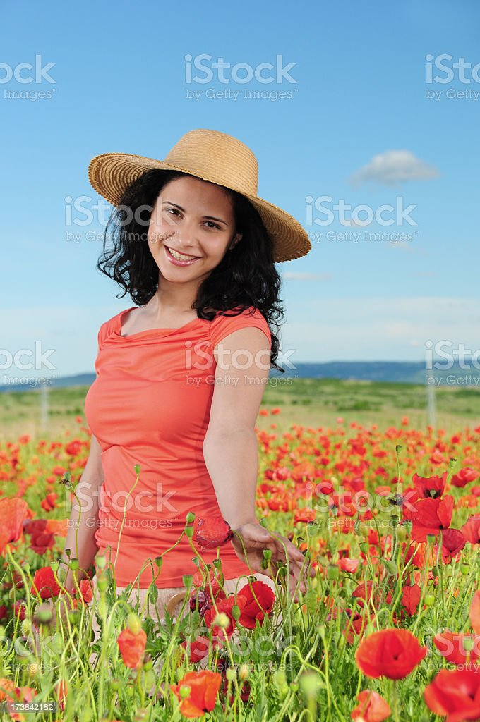 Woman in poppy field series royalty-free stock photo