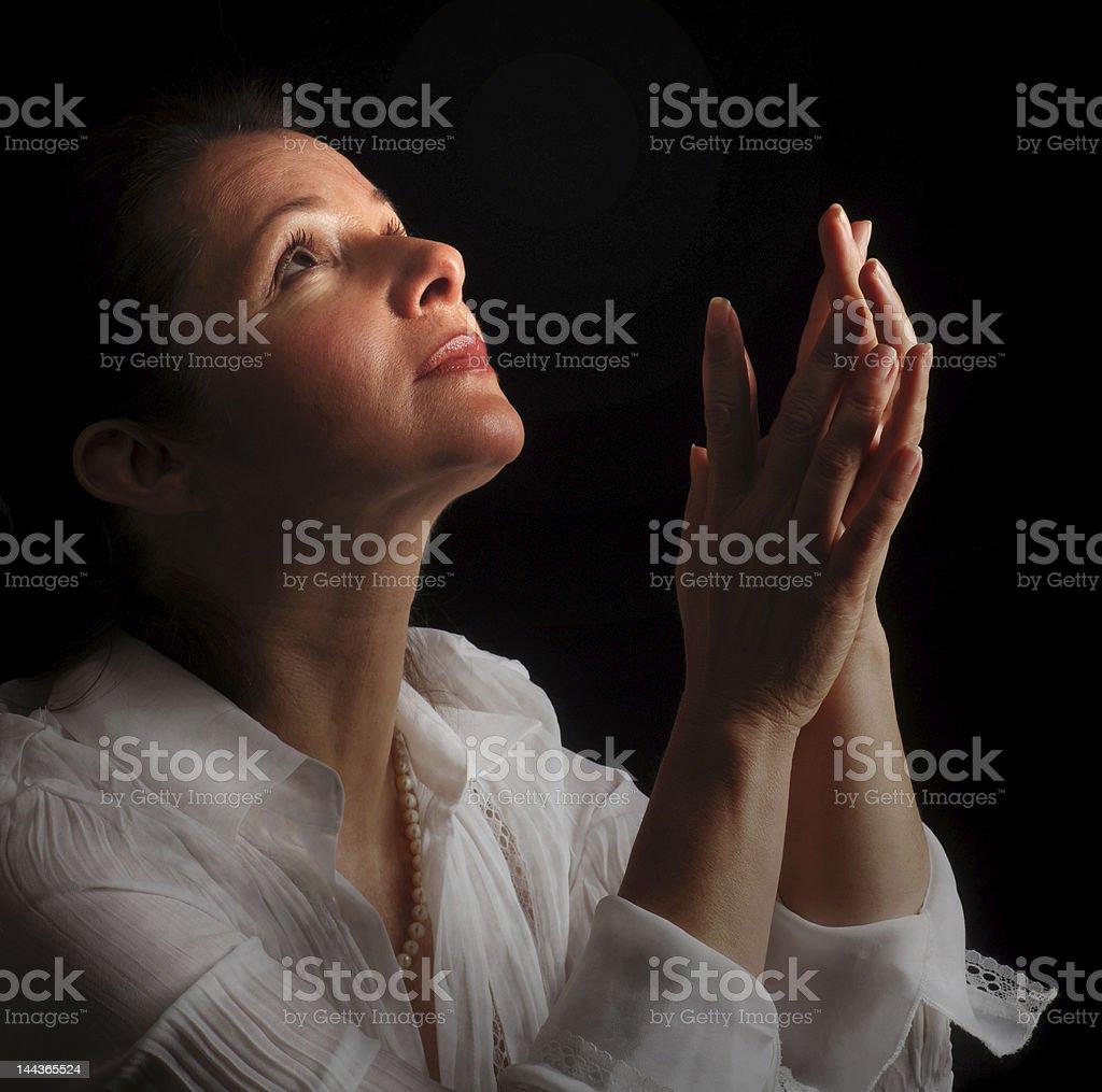 Woman in prayer royalty-free stock photo