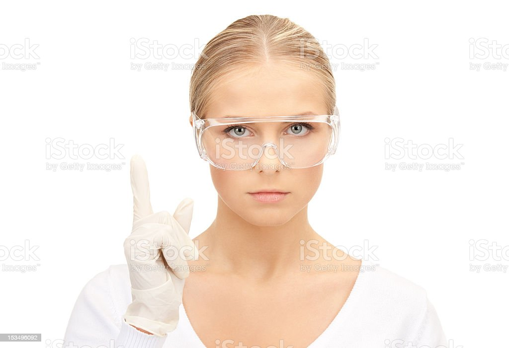 woman in protective glasses and gloves royalty-free stock photo