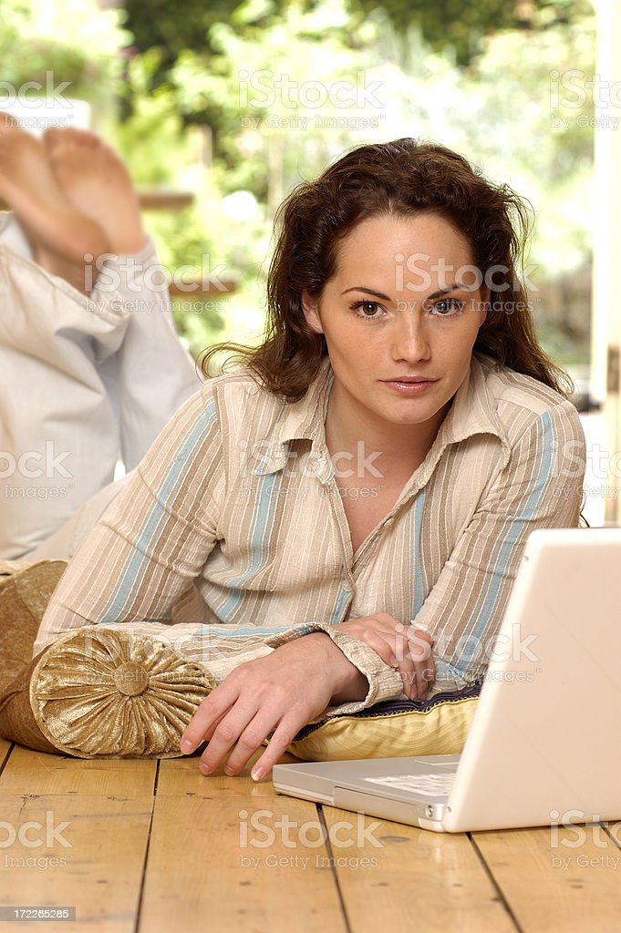 woman in pyjamas with laptop royalty-free stock photo